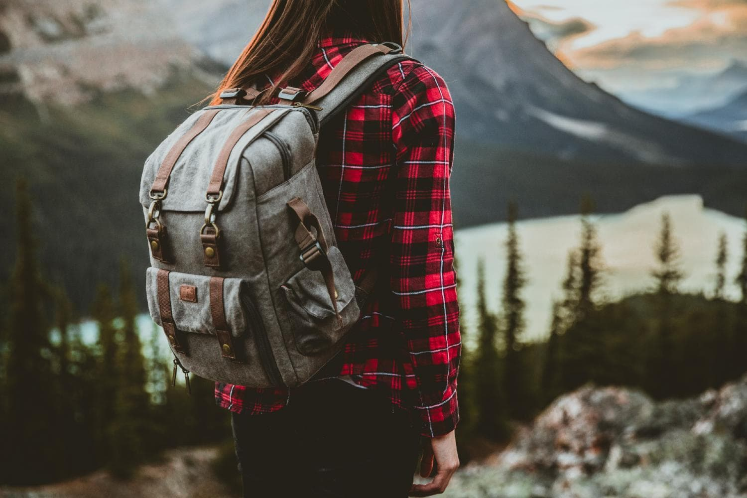 A girl standing with the backpack
