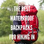Men standing facing back with big red hiking backpack
