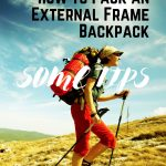 Women hiking with hiking sticks and big backpack