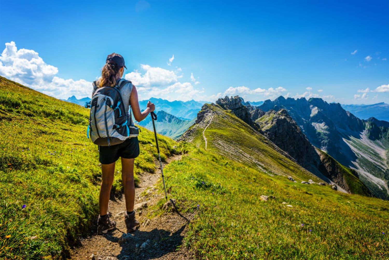 Woman alone hiking in the mountain