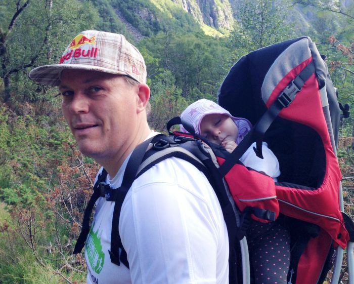 Thomas Sorheim hiking with his daughter sleeping in hiking child carrier