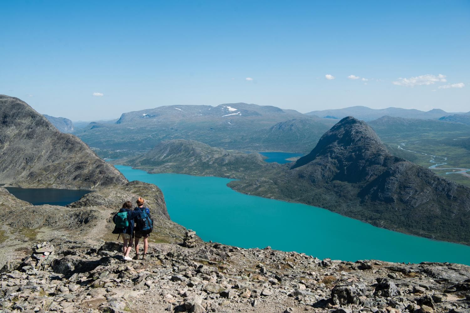 Two hikers about to hike the Besseggen ridge in Jotunheimen Norway
