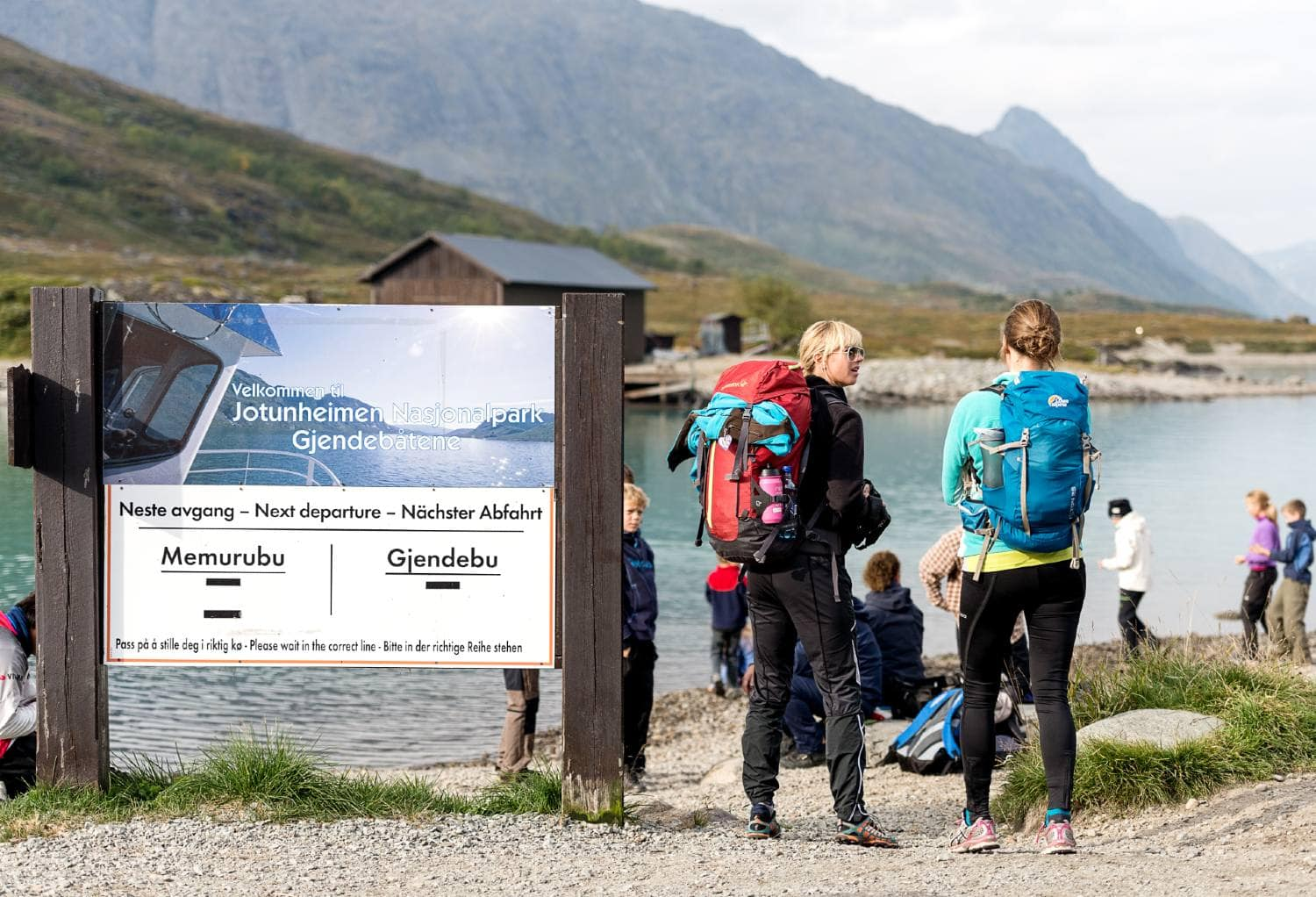 Hikers waiting for the boat to take them to Memurubu for the best start of Besseggen hiking