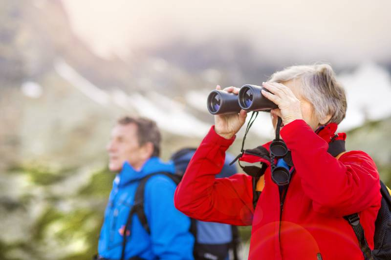 Hiking couple with binoculars