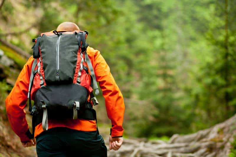 A man with the hiking backpack