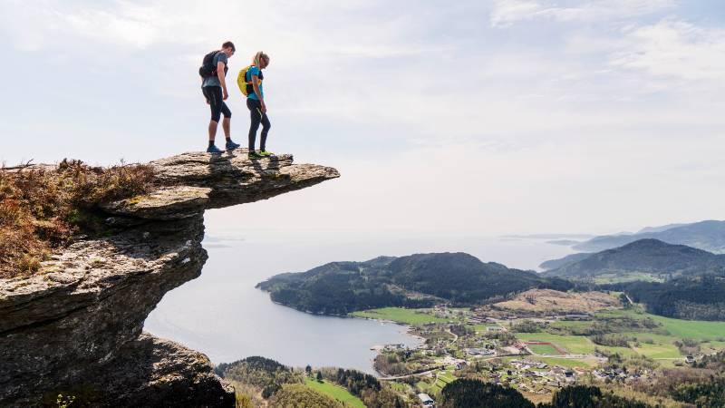 Two hikers standing on top of Himakånå in Haugesund Norway