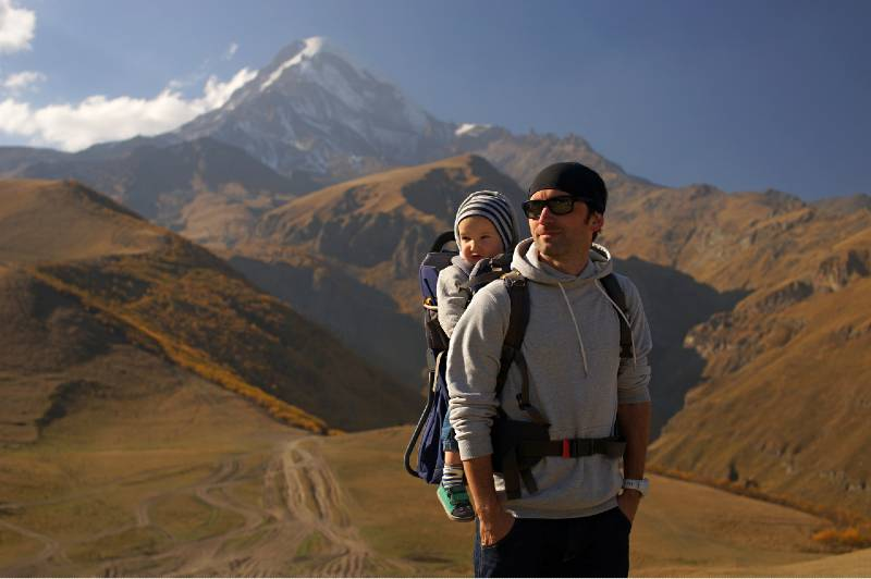 A man hiking with the baby in the carrier