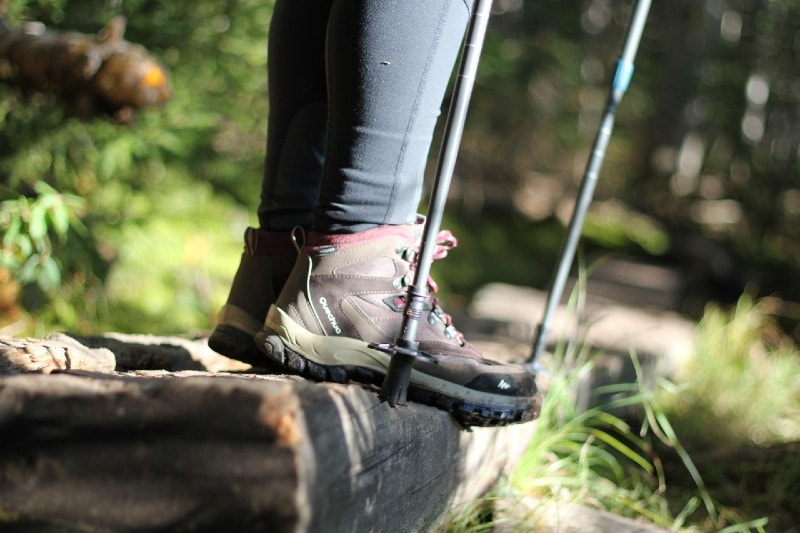 hiking boots and trekking poles